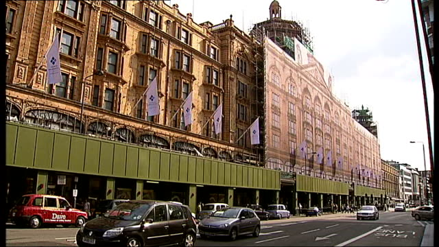 harrods exteriors 'harrods' name plate on marble wall / front of harrods store with boarded up facade and scaffolding / 'dubai properties' flags... - marble wall stock videos and b-roll footage