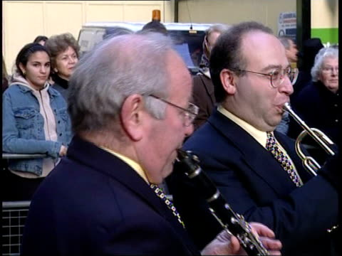 harrods opening; england: london: knightsbridge: harrods ext/itn gvs people queueing behind barriers outside store / gvs jazz band playing / gvs... - charlotte church stock videos & royalty-free footage