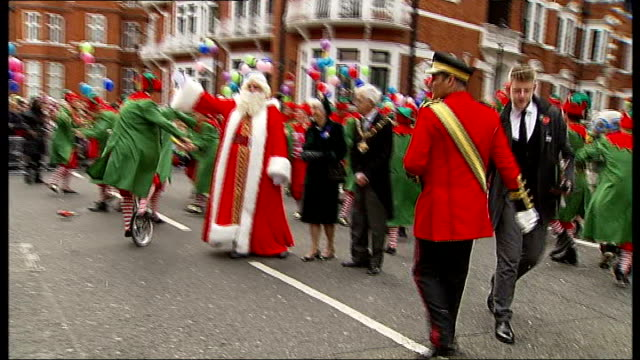 harrods stages annual christmas parade; england: london: knightsbridge: harrods: ext reindeer, dancing elves and santa claus taking part in christmas... - parade stock videos & royalty-free footage