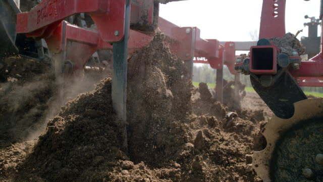slo mo harrow breaking up and smoothing the soil - tractor stock videos & royalty-free footage