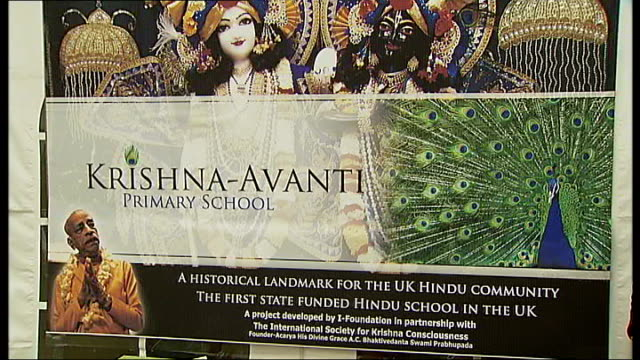 ceremony to mark start of building of state-funded hindu school; close shot poster 'krishna-avanti primary school' tilt down to model of proposed... - harrow stock videos & royalty-free footage