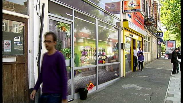 harrow council creates fake shop to attract retailers england north london harrow ext gvs exterior of fake florist shop in high street man walking... - harrow stock videos & royalty-free footage