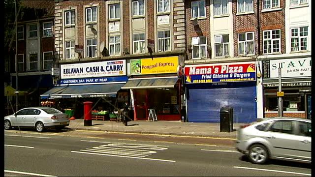 "harrow council creates ""fake"" shop to attract retailers; north london: harrow: ext gv shops in harrow high street to ""fake"" florist shop - harrow stock videos & royalty-free footage"