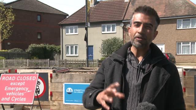 harrow council to scrap low traffic neighbourhoods; england: london: harrow: ext gvs planter boxes at end of road and low traffic neighbourhood signs... - politics stock-videos und b-roll-filmmaterial