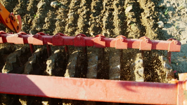 slo mo harrow smoothing and breaking up the soil - harrow agricultural equipment stock videos & royalty-free footage