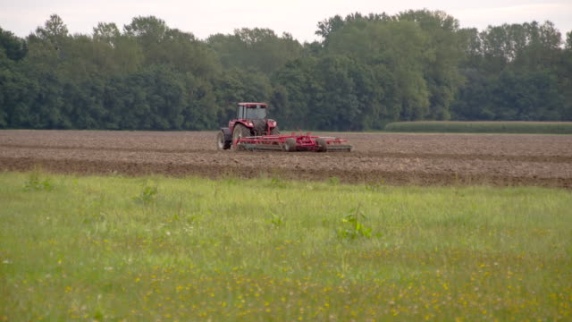 ls harrowing the field - plough stock videos & royalty-free footage