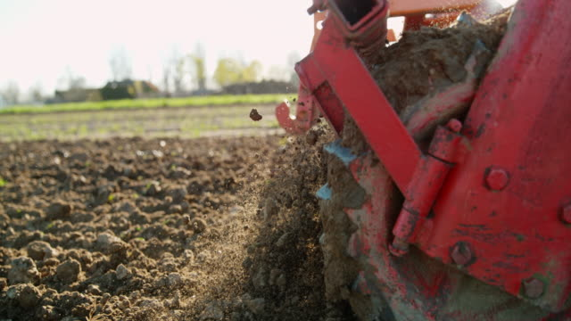 slo mo harrowing the field - harrow agricultural equipment stock videos & royalty-free footage