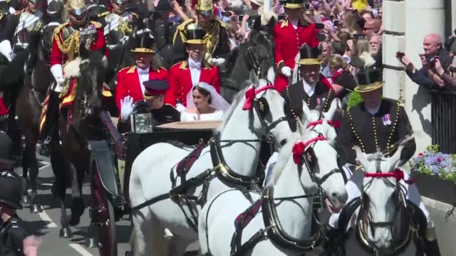 harry and meghan begin their procession through windsor just after their wedding at saint george's chapel - meghan harry stock videos and b-roll footage