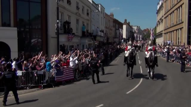 harry and meghan ride through the streets of windsor in a carriage after marrying at st george's chapel - st. george's chapel stock videos and b-roll footage