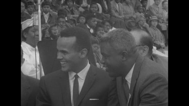 harry belafonte and jackie robinson at a civil rights rally on october 25, 1958 in washington d.c. - harry belafonte stock videos & royalty-free footage