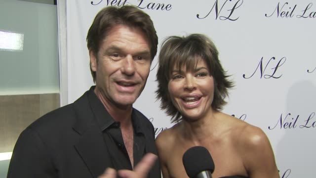 Harry Hamlin and Lisa Rinna on attending tonight's event on the appeal of Neil Lane jewelry and on their well wishes for Neil and his store at the...
