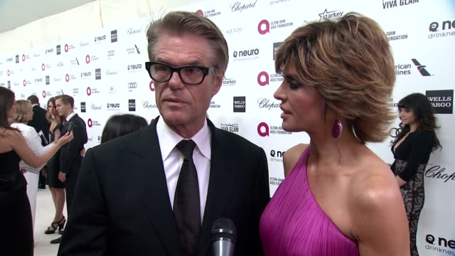 INTERVIEW Harry Hamlin and Lisa Rinna on the event and on Elton John at the 23rd Annual Elton John AIDS Foundation Academy Awards Viewing Party...