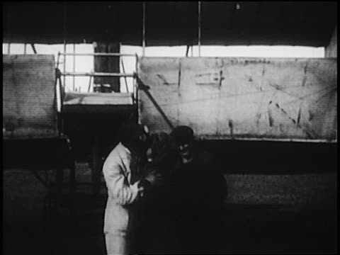 harry houdini climbing into biplane before flying stunt / australia / newsreel - anno 1910 video stock e b–roll