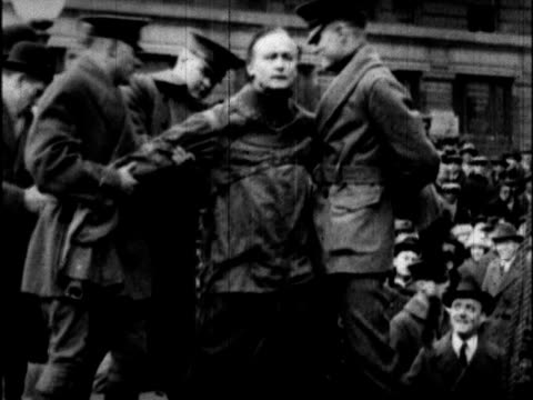 / harry houdini is put in straitjacket hoisted about the crowd upside down escapes tosses away straitjacket - hochziehen stock-videos und b-roll-filmmaterial