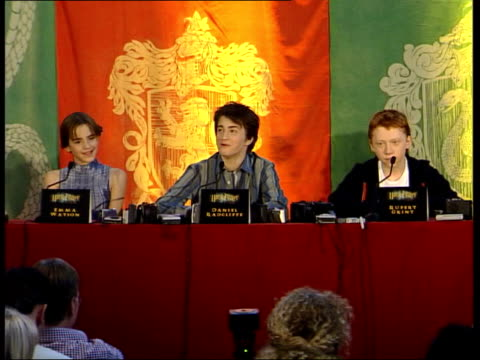 harry potter and the chamber of secrets released england london man holding owl at press conference ms harry potter actors daniel radcliffe emma... - harry potter stock videos & royalty-free footage