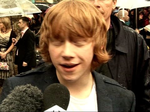'harry potter and the order of the phoenix': interviews with cast; rupert grint interview sot - in the last one he was a bit of a wimp / he was going... - big hair stock videos & royalty-free footage