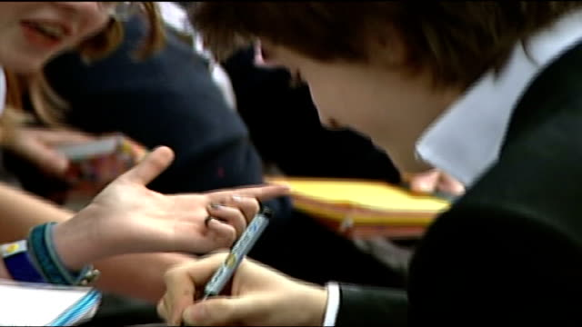 premiere itn england london leicester square ext daniel radcliffe along to sign autographs for fans cs radcliffe signing autographs tilt up tgv fans... - 2004 stock videos and b-roll footage