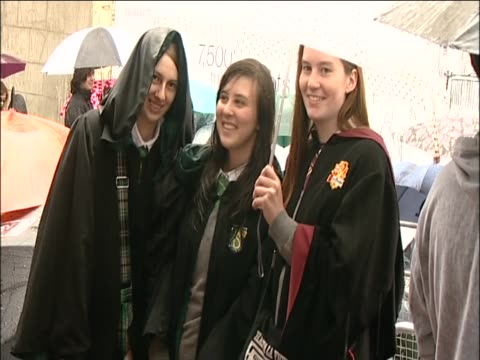 Harry Potter fans wait in the rain before the Deathly Hallows premiere