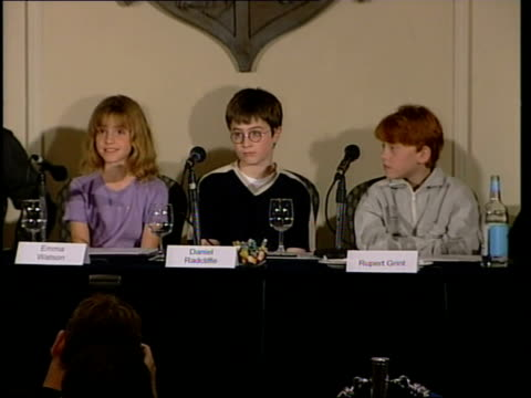 actors press conference; itn england: london: int watson radcliffe, watson and grint sat together as emma watson press conference sot - so far it has... - actor stock videos & royalty-free footage