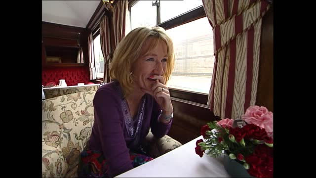 rowling interview; england: london: int train jk rowling interview with nik glass sot. q - how do you rate the new harry potter book? a - in some... - ensemblemitglied stock-videos und b-roll-filmmaterial