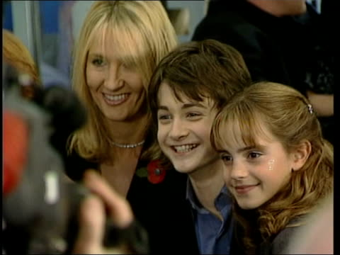 harry potter premiere itn daniel radcliffe interview sot talks of it being scary radcliffe and watson posing for photocall with harry potter author j... - harry potter stock videos & royalty-free footage