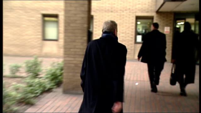 harry redknapp and milan mandaric tax evasion trial continues; england: london: southwark crown court: ext milan mandaric arriving at court to bv... - ハリー レッドナップ点の映像素材/bロール