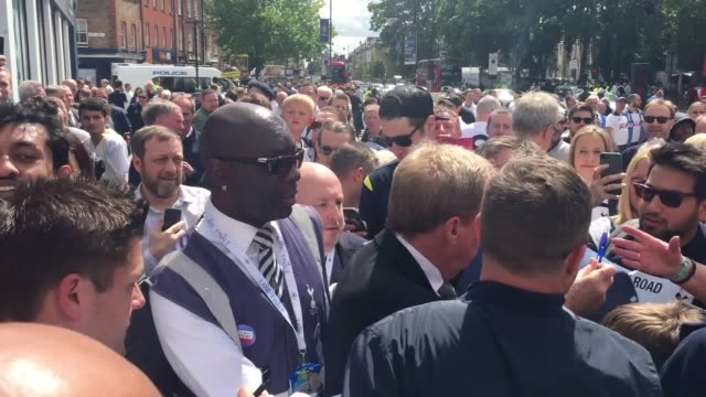 Harry Redknapp arrives at White Hart Lane for Tottenham's final game at the old stadium and is mobbed by fans while signing autographs