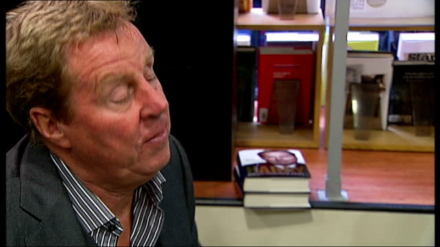 harry redknapp at book signing and interview; england: london: int harry redknapp signing copies of his autobiography books / harry talking to fan /... - 伝記点の映像素材/bロール