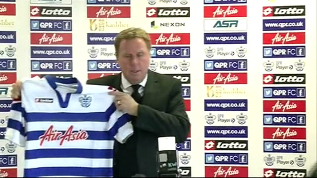 harry redknapp resigns as qpr manager r26111204 harlington int then new qpr manager harry redknapp posing for photocall with qpr shirt ****end - ハリー レッドナップ点の映像素材/bロール