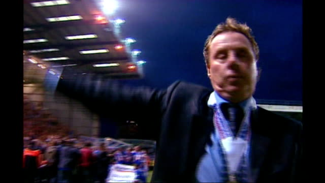 redknapp cleared of tax fraud file 2003 redknapp waving to fans with championship winners medal round neck redknapp sprayed with champagne by... - ハリー レッドナップ点の映像素材/bロール