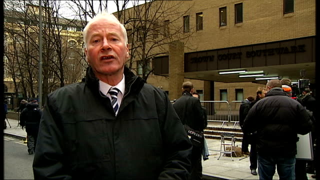 redknapp cleared of tax fraud reporter to camera photography ** redknapp leaving court through press scrum as someone shouts 'come on you spurs' sot - スクラム点の映像素材/bロール