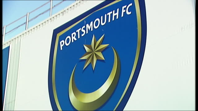Redknapp cleared of tax fraud 2312012 Portsmouth Fratton Park Portsmouth FC badge on side of stadium Groundsman mowing pitch Sun shining over Fratton...