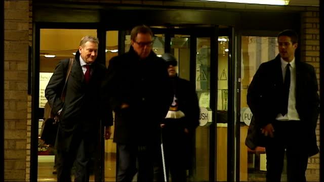 harry redknapp tax evasion trial: redknapp denies lying; england: london: southwark: harry and jamie redknapp leaving court - ハリー レッドナップ点の映像素材/bロール