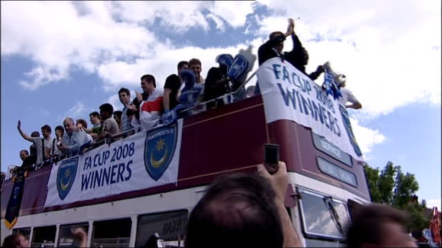 Redknapp outburst in court LIB Hampshire Portsmouth Portsmouth football players along on top of opentop bus to celebrate winning the FA Cup Crowd...