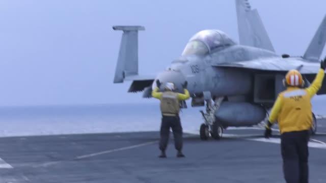 uss harry s truman and carrier air wing 1 conduct flight operations - flugzeugträger stock-videos und b-roll-filmmaterial