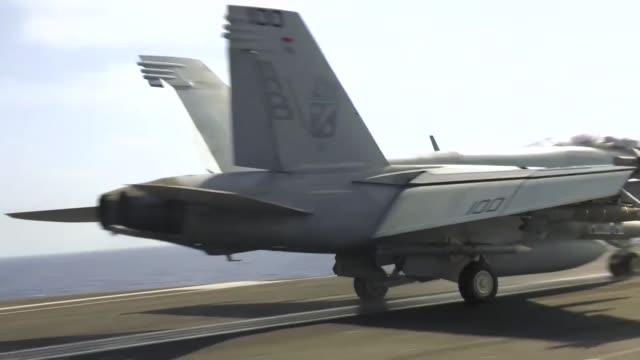 uss harry s truman conducts flight operations in the eastern mediterranean sea - flugzeugträger stock-videos und b-roll-filmmaterial