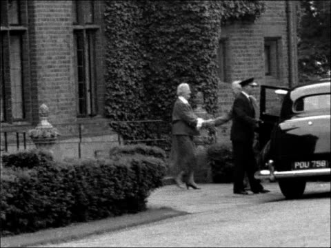 Harry Truman has lunch at Chartwell with the Churchills ENGLAND Kent Chartwell EXT General view of Chartwell / Two officers stood talking / Long shot...