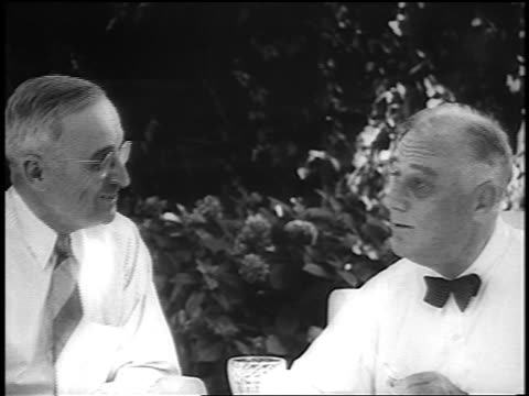 fdr harry truman sit talk at table outdoors on patio / truman looks at the camera - harry truman stock videos and b-roll footage