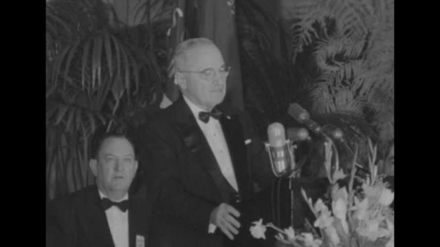 harry truman wearing black tie standing at lectern on head table at statler hotel speaking about a vfw gold citizenship medal and certificate of... - veterans of foreign wars of the united states stock videos & royalty-free footage