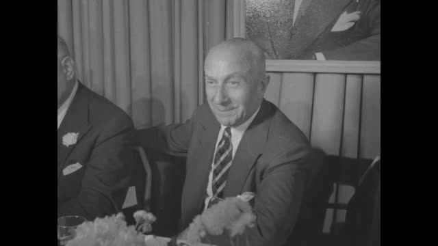 harry warner seated at head table at dinner honoring the warner brothers. - warner bros. stock videos & royalty-free footage