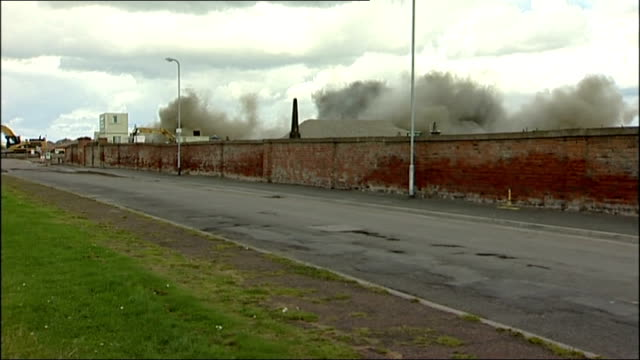 gvs demolition and interview england country durham hartlepool ext gvs young boy jamie browne pushing down plunger / explosion near base of steetley... - plunger stock videos and b-roll footage