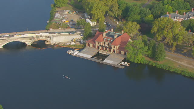 ws zo aerial pov harvard newell boathouse on the charles river, near the anderson memorial bridge / cambridge, massachusetts, united states - river charles stock videos & royalty-free footage