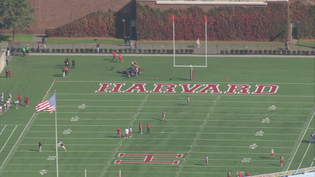 aerial harvard stadium with football training underway / boston, massachusetts, united states - harvard university stock videos & royalty-free footage