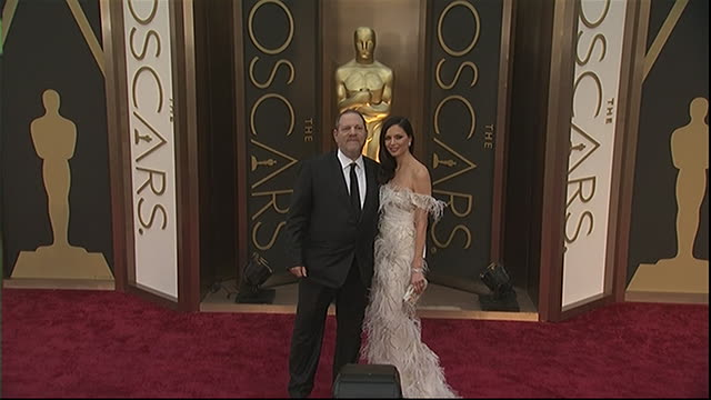 harvery weinstein and wife georgina chapman pose for photos on the red carpet at the 2014 academy awards. - 2014 stock videos & royalty-free footage