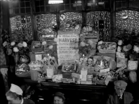 harvest festival service in kilburn england london kilburn ext lord palmerston pub sign tilt entrance to public bar / crowd of people at bar /... - publican stock videos & royalty-free footage