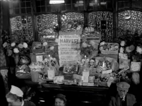vídeos y material grabado en eventos de stock de harvest festival service in kilburn england london kilburn ext lord palmerston pub sign tilt entrance to public bar / crowd of people at bar /... - tabernero