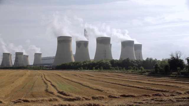 ws tu harvested field and coal fired power station / drax, yorkshire, united kingdom - coal fired power station stock videos and b-roll footage