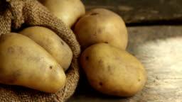 Harvested potato put on wooden desk at kitchen