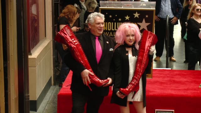 stockvideo's en b-roll-footage met harvey fierstein and cyndi lauper at hollywood walk of fame on april 11, 2016 in hollywood, california. - cyndi lauper