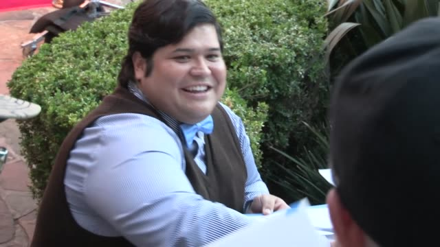 harvey guillen greets fans at the internship premiere in westwood, 05/29/13 - westwood video stock e b–roll